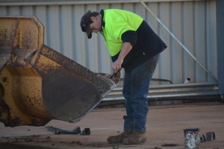 Replacing teeth on the loader bucket