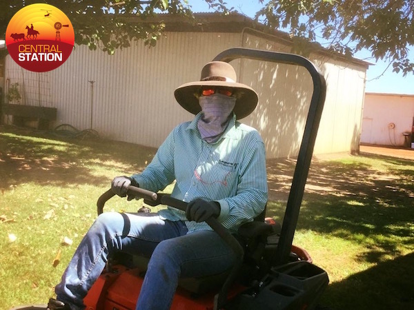Blog 5.3A Mowing the lawn with full sun protection. copy